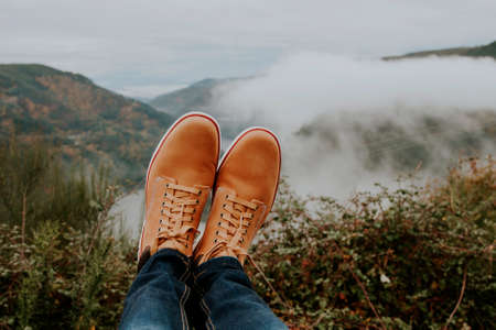 sil: boots in the foreground on the panoramic view of the Valley, concept of adventure and travel