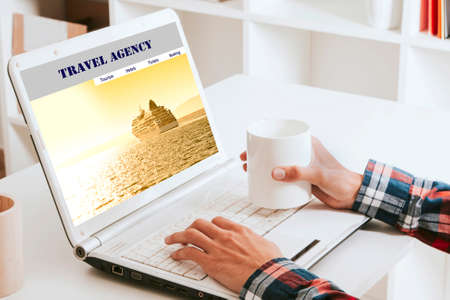 manos: man consulting trips online with a coffee Stock Photo