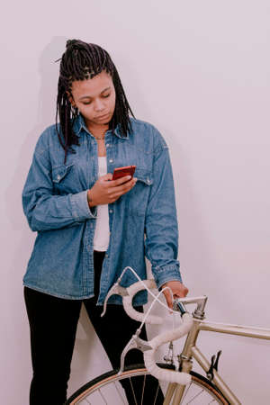 youngs: girl youngs style casual with the phone mobile in the wall white