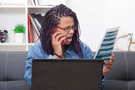 screaming and calling by phone with the document in her hand