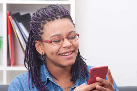 female young african descent with the phone mobile Stock Photo