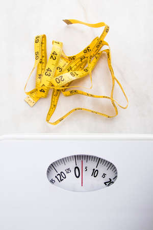 calory: scale with tape measure, concept of weight loss and diet