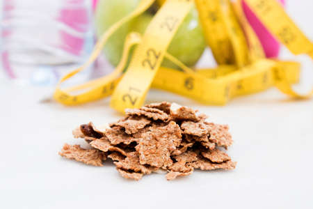 cereals integral with background of tape measure, fruit and water, dieting