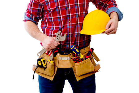 constructor with helmet and tools Stock Photo