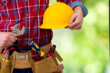 the construction worker and technician on background Stock Photo