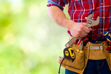 pawns: the construction worker and technician on background Stock Photo