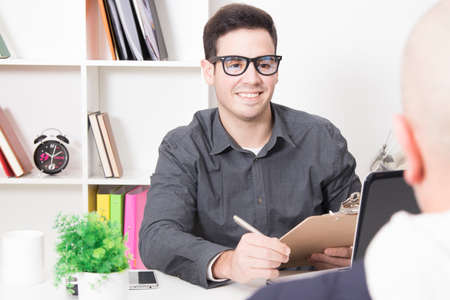 contracting: advisor or professional attending business meeting in the office customer