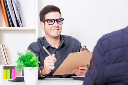 man of business in the office with the documents to the customer or employee