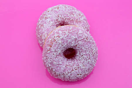 candy donuts isolated on a pink background