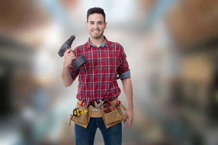 young smiling with drill or screwdriver, bricolage and repair man