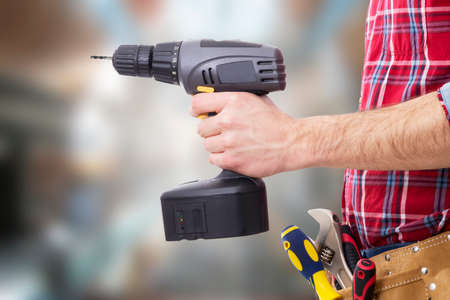 hand with the drill or screwdriver isolated, DIY and tools