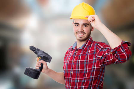 oneself: worker happy with the drill of DIY and construction