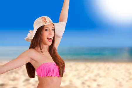 girl on the beach in sunny summer day Stock Photo