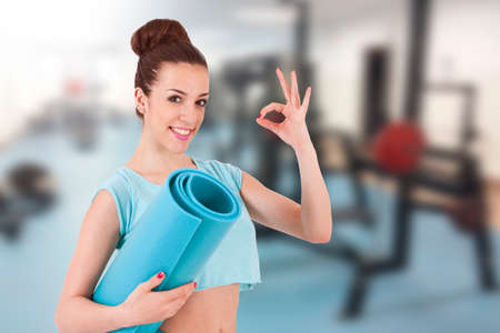 young girl in the gym doing exercises