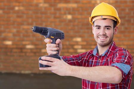 builder with the drill on outdoor background