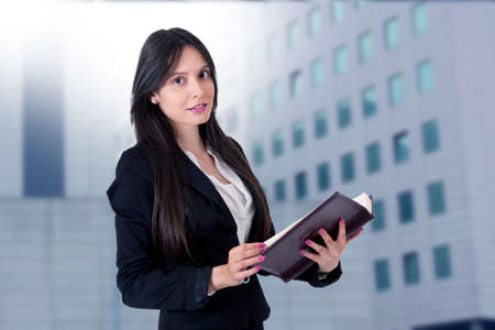 businesswoman with address book or calendar Stock Photo