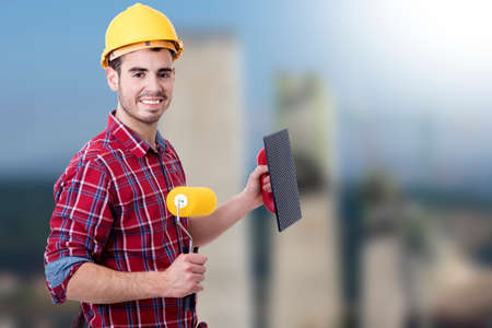 bricklayer tools to work and paint, builder Stock Photo