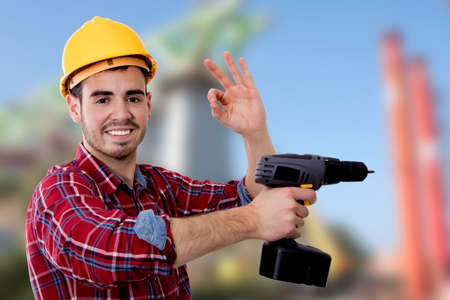 builder with the drill and the sign of approval, okay Stock Photo