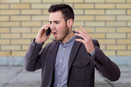 man shouting by the phone mobile