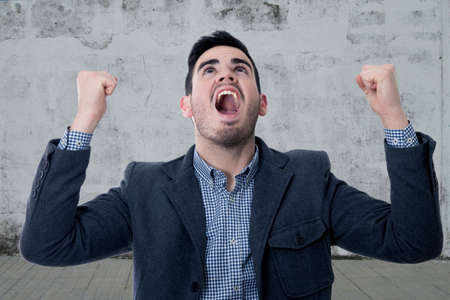 exaltation: modern screaming young man Stock Photo