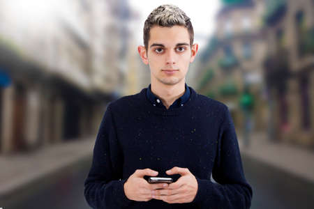 man young teen with the phone mobile
