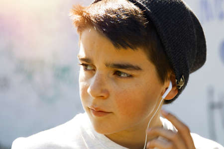portrait of a boy outside with headphones