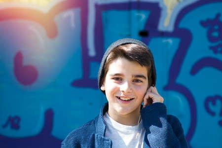 child outdoor with headphones Stock Photo
