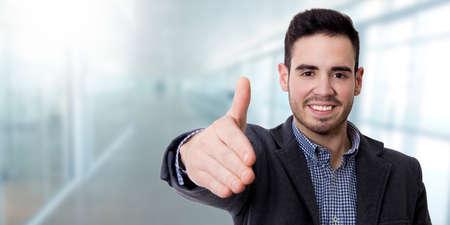 young smiling waving man Stock Photo