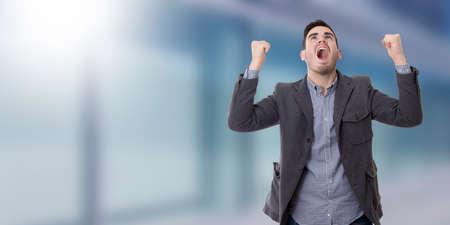 enraged: adult young man shouting enraged with the arms raised Stock Photo