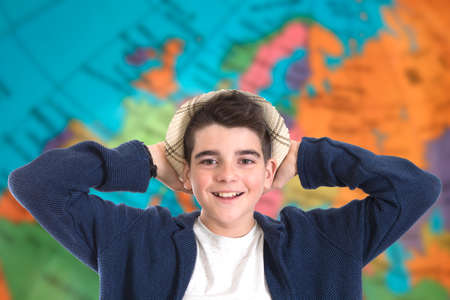 portrait of a boy with the background world map Stock Photo