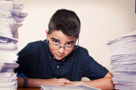 student at the desk studying, school and children Stock Photo