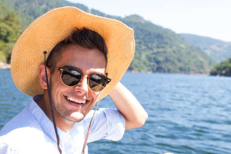 portrait of adventurer with hat on the river Stock Photo