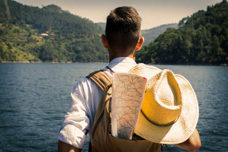 traveler with backpack and map Stock Photo