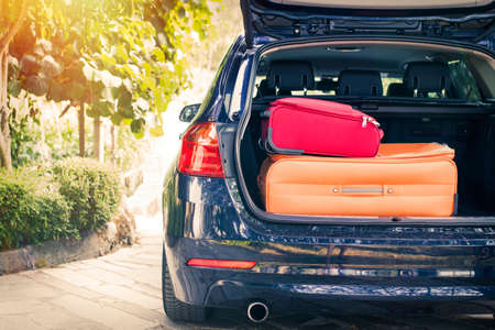 Car with suitcases in the boot, travel and luggage concept