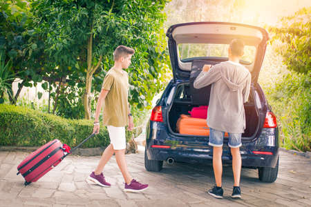 family travel with car and suitcases