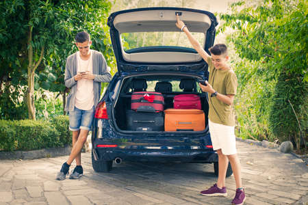 family travel with suitcases and car Stock Photo