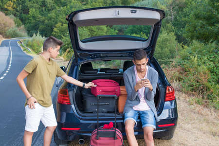 young people with luggage and car to travel