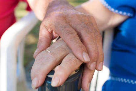 hands hugged by older people, seniors