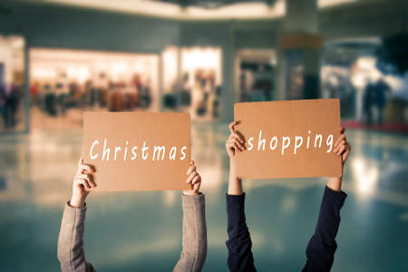 children with christmas shopping sign Stock Photo