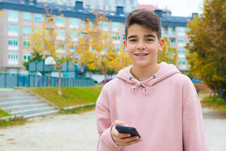 teenager with mobile phone on the street