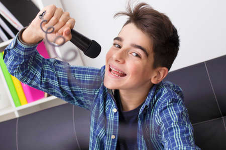 child, teenager or preteen singing with the microphone