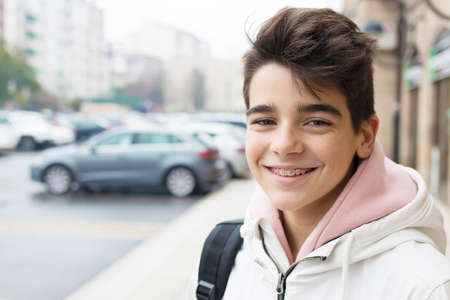 portrait of young teenager on city street