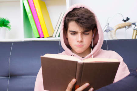 adolescent or preteen student with the textbook at home Stock Photo