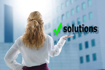 young woman holding the concept of solutions Stock Photo