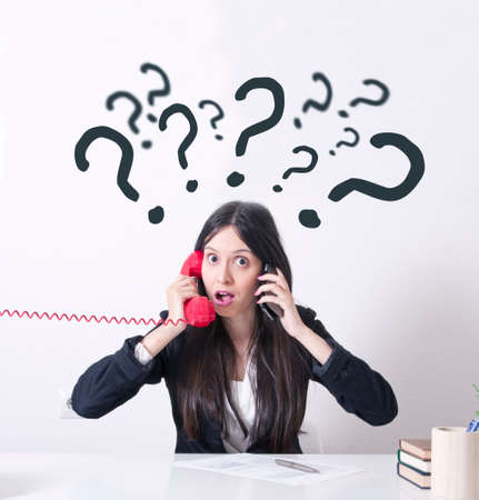 woman in the office with problems and stress on the phone