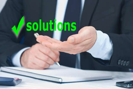 man business hand with the concept of solutions