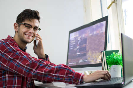 young man with computer working or studying at the desk Stock Photo