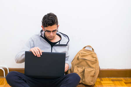 student with the computer and backpack of the college or university