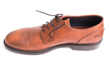 brown leather shoes insulated in white background