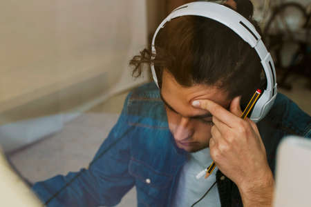 working with headphones at home or in the office at the desk